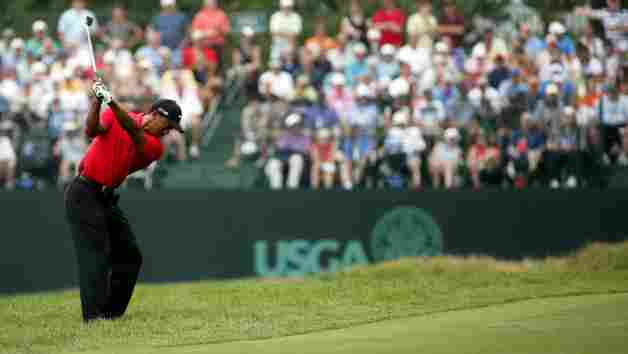 ARDMORE, PA - JUNE 16: Tiger Woods of the United States hits an approach shot on the second hole during the final round of the 113th U.S. Open at Merion Golf Club on June 16, 2013 in Ardmore, Pennsylvania. (Photo by Rob Carr/Getty Images)