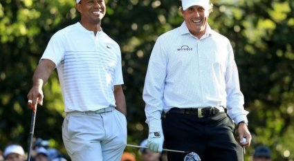 an in-depth review of the upcoming great golf duel between Tiger Woods and Phil Mickelson.